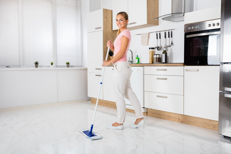 Woman Cleaning Tile Floor