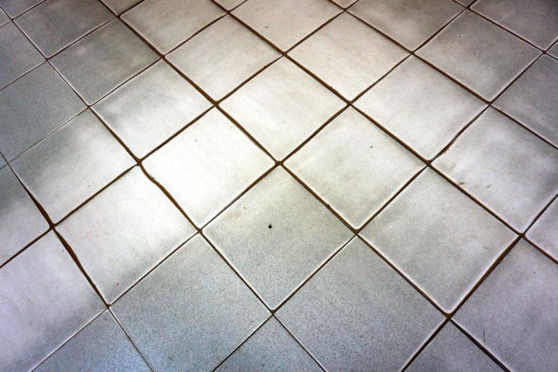 Old Uneven Tile Floor