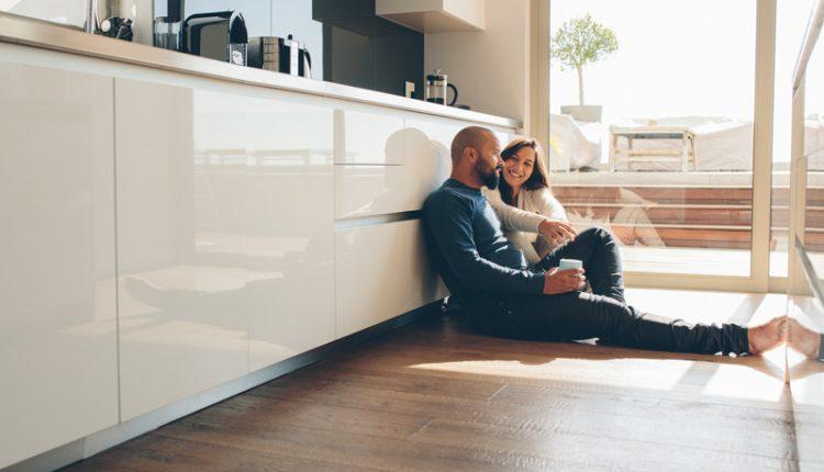 Couple Sitting on Floor
