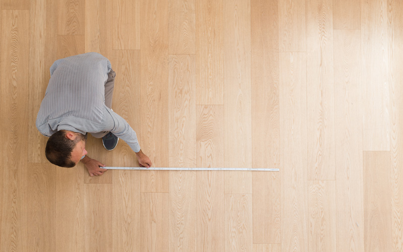 Man Measuring Laminate